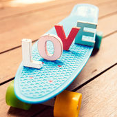 Word love on the blue penny board — Foto Stock
