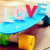 Word love on the blue penny board — Stock Photo
