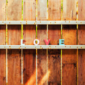 Word love on a wooden door in fence — Stock Photo