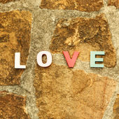 Word love on the stone floor — Stock Photo