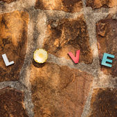 Word love on the stone floor — Stock Photo