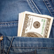 Jeans with american dollar bills in its pocket — Stock Photo #60589603
