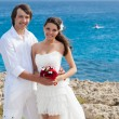 A just married couple on the beach — Stock Photo #69598125