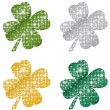 Glittering Clovers — Stock Vector #67198279