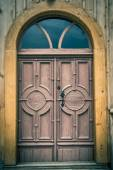 Old wooden semicircular front door in an old church — Stock Photo