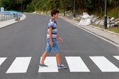 Teenager through a zebra crossing — Stock Photo