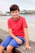 Smiling teenager on holiday at the coast  — Stock Photo