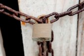 Closed padlock with rusty chain — Stock Photo