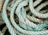 Photo of an old worn rope rolled  — Stock Photo
