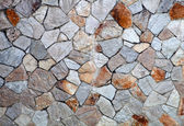 Gray stone wall with built   — Stock Photo