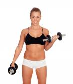 Attractive girl training with dumbbells — Stock Photo