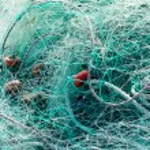 Tangled green fishing nets — Stock Photo #55045763