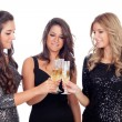 Three friends with sparkling dresses toasting — Stock Photo #56826741