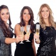 Three friends with sparkling dresses toasting — Stock Photo #56826971
