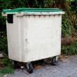 Waste container with green lid — Stock Photo #56827521