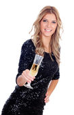 Attractive blonde woman wearing black sequins toasting with cham — Stock Photo