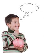 Smiling child with a moneybox thinking — Stock Photo