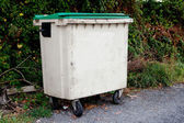 Waste container with green lid  — Stok fotoğraf