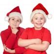 Two children with Christmas hats — Stock Photo #58429473