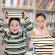 Four children in the library — Stock Photo #58429515