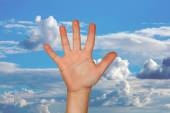 Outstretched hand with a nice blue sky — Stock Photo