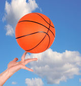 Hand holding a basketball  — Stock Photo