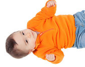 Adorable six month baby with orange jersey lying — Stock Photo