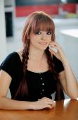 Rebellious teenager girl with red hair at home — Stock Photo