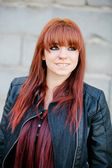 Rebellious teenager girl with red hair smiling — Stock Photo