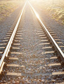 Railroad track sunlit — Stock Photo