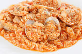 Delicious rice dish with clams — Stock Photo