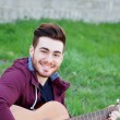 Cool handsome guy playing guitar at outside — Stock Photo #71080543
