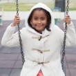 Black girl playing with a swing — Stock Photo #71081043