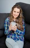 Girl holding cup with hot drink — Stock Photo