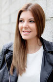 Cool young woman with black leather jacket — Foto de Stock