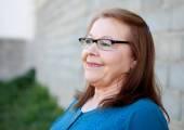 Senior woman smiling, outdoors — Stock Photo