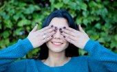Brunette girl covering her eyes  — Stock Photo
