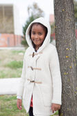 Pretty african girl with winter clothes — Stock Photo