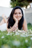 Brunette woman on a flowered meadow — Stock Photo