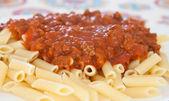 Delicious plate of macaroni with tomato   — Stock Photo