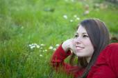 Young woman lying in grass — Stock Photo