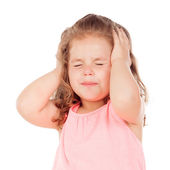 Little girl making angry face — Stock Photo