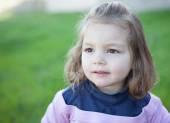 Cute little girl posing at camera — Stock Photo