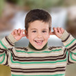 Nice boy covering the ears — Stock Photo #77919960