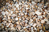 Wallpaper with small stones — Stock Photo