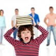 Crazy child with books on head — Stock Photo #77920346
