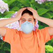 Child with a mask to prevent allergy — Stock Photo #77920430