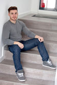 Casual man sitting on the stairs — Stock Photo