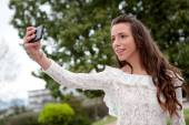 Cool pretty woman with a mobile — Stock Photo