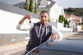 Man with keys of his new car — Stock Photo
